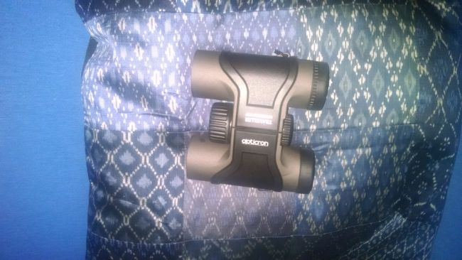 Opticron Traveller BGA Mg 8x32s on a blue pillow